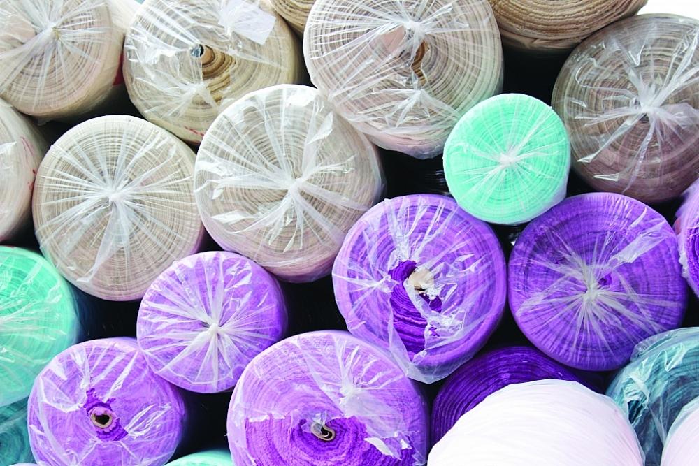 Cơ quan Hải quan đã phát hiện một số vụ việc vi phạm trong sử dụng nguyên liệu dệt may của loại hình gia công sản xuất xuất khẩu và chế xuất. Ảnh: T.Bình
