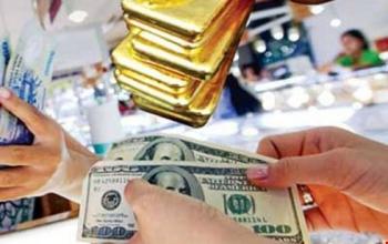Giá vàng tụt dốc, USD tăng mạnh