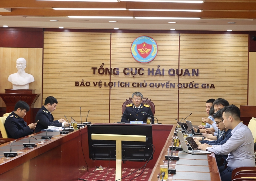 Phó Tổng cục trưởng Mai Xuân Thành chủ trì buổi làm việc nghe Công ty FPT trình bày giải pháp ngày 17-3. Ảnh: T.Bình.
