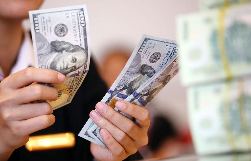 Giá USD tăng vọt, giá vàng đi xuống sau tín hiệu từ Fed