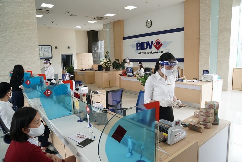 Các ngân hàng đã cam kết giảm lãi suất số tiền giảm là 20.300 tỷ đồng. Ảnh: BIDV