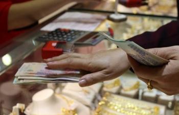 Giá vàng vẫn trên đà giảm, Nhân dân tệ tăng giá