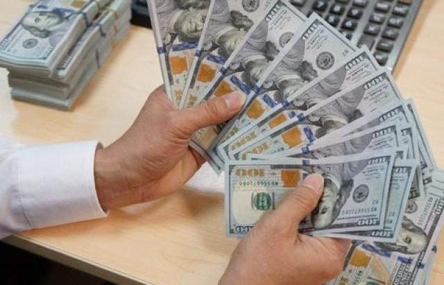 Giá USD giảm nhẹ dù giá vàng cũng đi xuống
