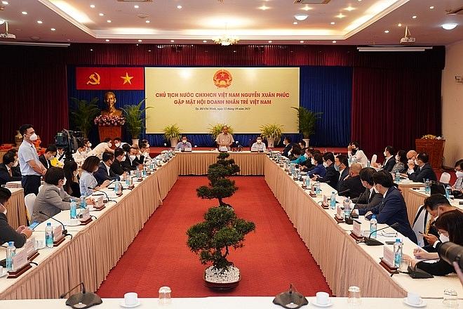 Toàn cảnh buổi gặp mặt giữa Chủ tịch nước và các doanh nhân tại TPHCM. Ảnh: Kiều Hoa).