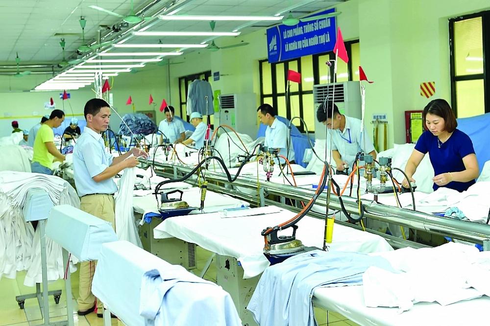 Doanh nghiệp dệt may đã thích ứng khá nhanh để nắm bắt cơ hội từ sự chuyển dịch đơn hàng, sự phục hồi của thị trường XK. Ảnh: N.Thanh