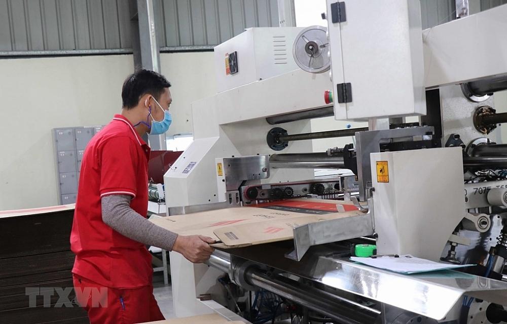 Sản xuất tại Công ty TNHH Trần Thành, khu công nghiệp Tiên Sơn, huyện Tiên Du, tỉnh Bắc Ninh. Ảnh: TTXVN.