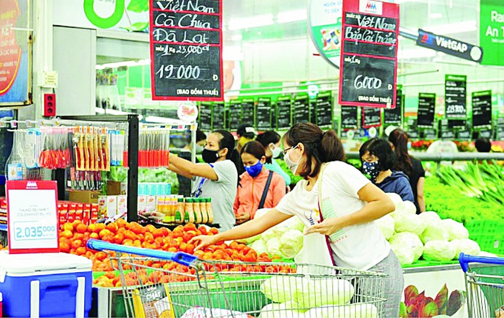Chính phủ đang đẩy mạnh kích cầu tiêu dùng nhằm hỗ trợ tăng trưởng kinh tế.  Ảnh: ST