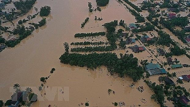 Lũ lớn trên sông Hiếu gây ngập diện rộng tại khu vực xã Thanh An, huyện Cam Lộ và phường Đông Giang, thành phố Đông Hà, tỉnh Quảng Trị. (Ảnh: Hồ Cầu/TTXVN)