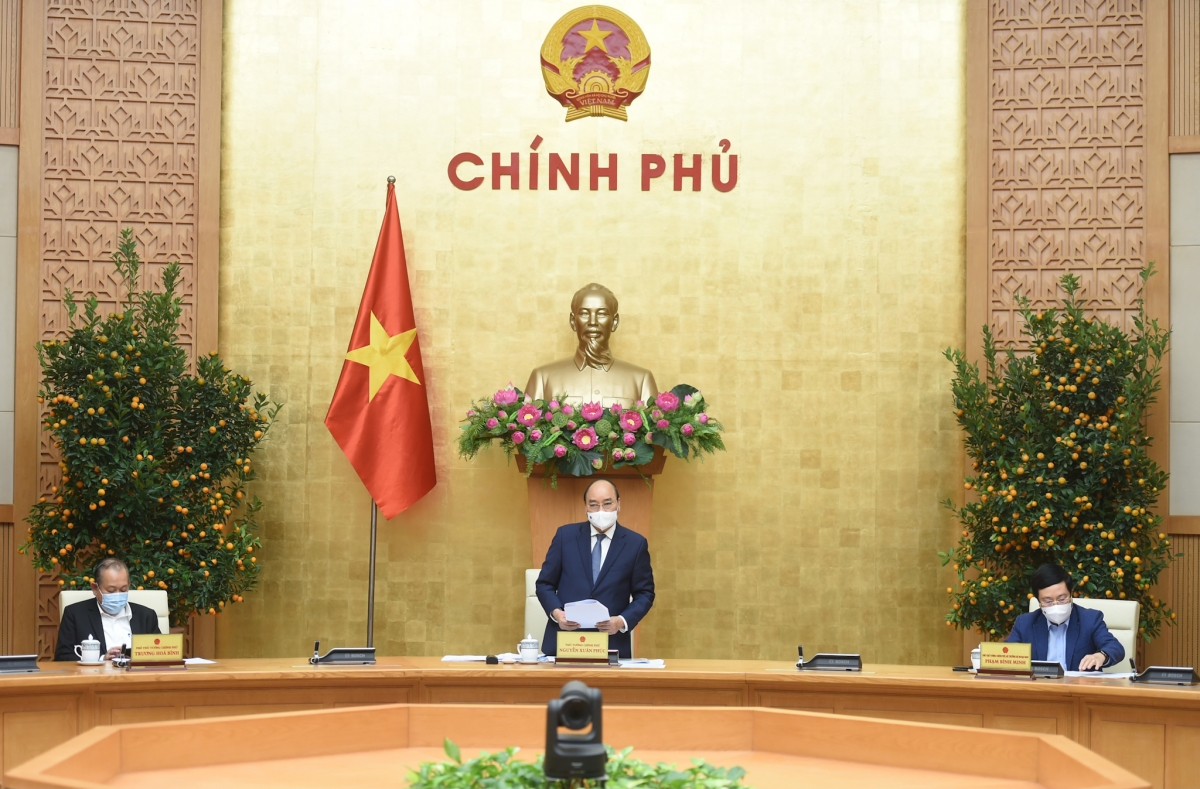 Thủ tướng Nguyễn Xuân Phúc chủ trì cuộc họp Thường trực Chính phủ bàn về tình hình Tết, triển khai các nhiệm vụ trọng tâm sau Tết và công tác phòng chống dịch Covid-19. Ảnh: VGP