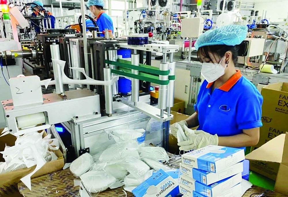 Doanh nghiệp mong sớm phục hồi hoạt động sản xuất kinh doanh. Ảnh: Lê Hương